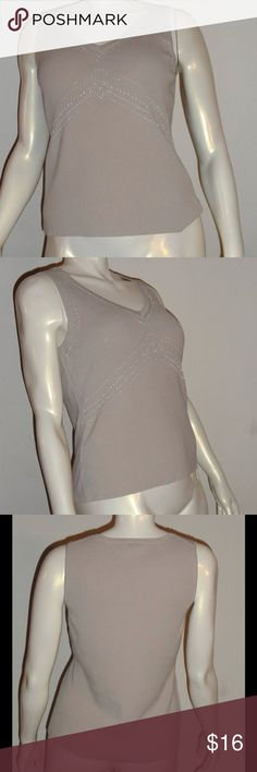 Ann Taylor Loft Sleeveless Knit Top Size XL Beautiful sleeveless top by Ann Taylor Loft features an intricate beaded design. This light grey top is an excellent addition to your work week wardrobe. It can also be dressed down for a more casual setting. There are no flaws, no holes, and no stains. Size XL LOFT Tops Tank Tops