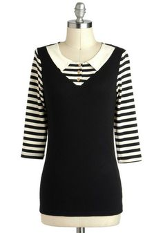 Clothing that looks nautical, French, and/or mime-inspired. sz M.
