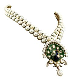 Sunita Shekhawat's three-dimensional peacock necklace studded with polki, pearls and enamel.