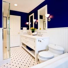 Vibrant blue and white bathroom with double vanity.