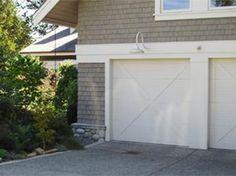 Garage barn doors with gooseneck light fitting