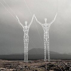 Iceland electric columns in the form of unusual walking iron giants. Functional art, monumental sculpture.