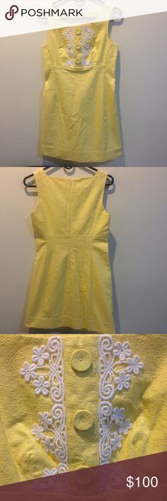 Lilly Pulitzer Canary Flower Lace Shift Dress Lilly Pulitzer gorgeous dress- never worn. Canary yellow with white flower lace detail in the front chest along with three buttons that don't function (just for show). Lined in cotton and zipper for closure in back. Above knee length! In great condition! Size 2. Lilly Pulitzer Dresses Mini