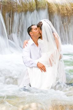 I've actually been in this waterfall (Jamaica), but not in a wedding dress. Stunning.