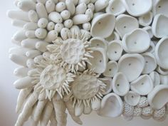 Designed to capture movement among species, this sculpture contains five varieties of sea life that come alive on your walls. Each piece is hand-sculputed and attached to a sturdy base with holes in the back for hanging flush against your wall. A unique addition to an art collection, this three-dimensional sculptural piece will keep your guests mesmerized by its unique complexities.  Color: White Size: 9 x 7 *Images shown in matte finish