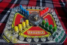 Trouble. We all used to play it. Simple and killer! :-)