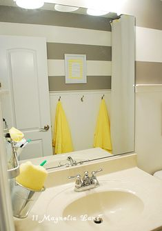 good idea: for kids bathroom, hang IKEA metal pots on towel bar for easy access to toothbrush/paste, drink cup, washcloth, etc.