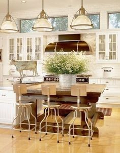 Love the lights, the cow, the stools, THAT HOOD and RANGE, the cabinets.....need I go on.  Gorgeous industrial / farmhouse kitchen!