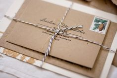 brown paper packages tied up with string. by kerry
