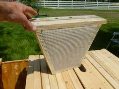 A candy board insert for a top bar hive. Top Bar Bee Hive, Bee Hive Plans, Beekeeping For Beginners, Candy Board, Beekeeping Equipment, Raising Bees, Bee Swarm, Backyard Beekeeping, Hobby Farms