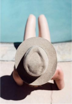 Lisa Dengler, of Just Another Me, wearing our AW Milford hat poolside this summer in Palm Springs