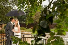 Lots of rainy luck for these two! www.ryangreenphotography.com  Austin Wedding Photographers - photos by Ryan & Lindsey Green