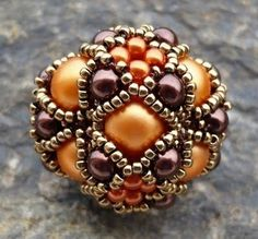 Gorgeous beaded bead. I love the color combination.