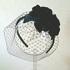 Birdcage fascinator headband Statement piece! Black, birdcage veil fascinator with two black silk roses. Secured to satin covered headband. This is our basic model. Upgraded versions will be listed soon.   Color: Black Size: One size Style: Blusher veil. Covers one eye at a slant.  Second photo shows an upgraded version only.   Happy to bundle to save on shipping. Will try to help with discounted s&h the best I can.   FIRST 10 NEW ORDERS receive FREE GIFT!!!  Thanks for visiting!! Laura C…