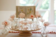 This was for a baby shower, but I love the vases with the single crepe paper flowers.