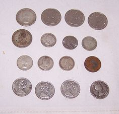 "Item specifics   Seller Notes: ""circulated coins with wear""      									 			Circulated/Uncirculated:   												Circulated  									 			Country of Manufacture:   												Canada   							 							  Group 16 Vintage Canadian Coins Some Silver Quarters,Dimes, Nickels, One..."