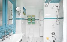 A faded pink bath became a well-organized space with period touches and oceans of blue and white tile