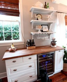 I'm really liking how they used the shelves to install the underneath-a-cabinet wine glass racks <3.  10 Awesome IKEA Hacks for the Kitchen