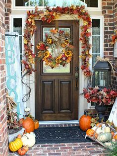 Play up small entryways with bold, attention-grabbing elements that make the space pop. A sunflower-and-burlap wreath and coordinating leafy garland draw the eye in, and layers of colorful decorations, such as baskets of gourds and a foliage-bedecked lantern, hold the viewer's attention. Welcome neighbors to your harvest-theme stoop with a space-saving vertical signboard.