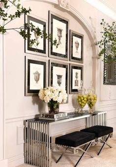 The masculine chrome  console table is so unexpected in this otherwise traditional vignette