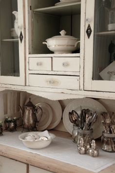Cream antique China cupboard with white dishes...Magnolia Cottage