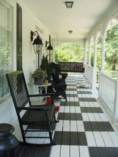 great country porch. Love the checkered floor!