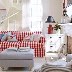 With a red-and-white plaid sofa as an anchor, it's easy to decorate for the Fourth of July. A quartet of decorate pillows turn the couch into Independence Day central, while a red milk-can lamp base adds a splash of homespun appeal.