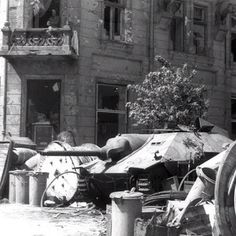 Polish barricade with captured Jagdpanzer tank destroyer at Napoleon Square Warsaw Poland 3 August Pin by Paolo Marzioli Mg 34, Warsaw Ghetto, Warsaw Poland, Warsaw Uprising, Sherman Tank, Tank Destroyer, History Online, Ww2 Tanks, Red Army