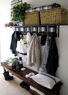 I really like this. it would probably be perfect in our front entryway. I'd like to use it for guests to hang their coats, slip off their shoes, etc.  {Entryway Reveal - Home Remedies}