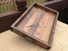 This hand crafted Rustic Wooden Ottoman Tray is a perfect way to add some charm to your home. Each wooden tray is made from pine and stained with a dark walnut stain giving each tray a rustic feel. We also apply a polyurethane sealant to each tray to insure it lasts for years to come!  You will find many uses for this tray in your own home. From being a great decor piece, entertaining guests, to serving your sweetie breakfast in bed, the options are endless!  **This listing is for the wooden…