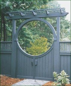 Custom Moon Arbor - Delightfully complementing the concave scallop top board gate is a cedar Moon Arbor with single arch and special stain color. The design has a flavor of the Orient. This Moon Arbor could also be made in solid cellular vinyl.