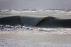 Freezing ocean waves in Nantucket are rolling in as slush