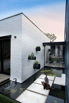 You can never go wrong with black and white, and in this case it makes for a stunning exterior ...