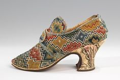 British Shoes wool, linen, silk   1750–69  The very bold, colorful, and finely worked flame stitch upper is an immediate eye-catcher on this pair of latchet shoes.   A common embroidery style, flame stitch canvas work is preserved in many specimens from the period, although this example has an unusual level of variety in the pattern