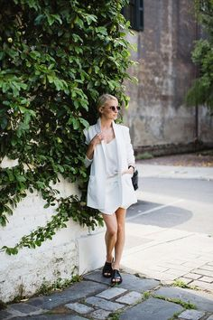 All white with a pop of black. We love this entire look!