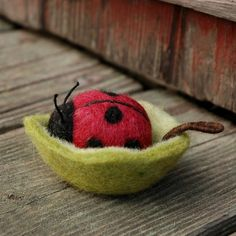 Little felted ladybird in her leaf bowl