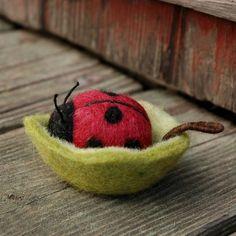 Little felted ladybird in her leaf bowl