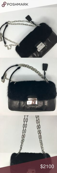 Prada bomber bag mink fur B5023L Brand new with tags prada shoulder bag Brand: Prada Model: B5023l Bomber Nappa+VI Color: Black (Nero) Material: Mink fur and soft leather Entry: Push lock closure Hardware: Silver tone hardware Lining: Leather lining Handles: Double shoulder straps with chain detail Exterior pockets: 1 slip pocket secured by snap tab closure Interior pockets: 1 zipper pocket, 1 slip pocket Includes Made in Italy Authenticity Card Included Approximately 6 inches…