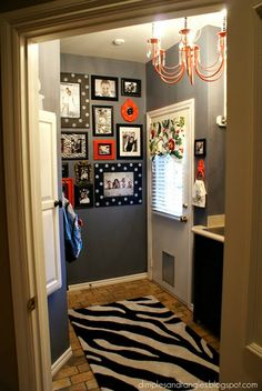"""walls with a funky flair (featured on Home Stories A to Z based on post from Dimples and Tangles blogspot) dimplesandtangles...  Note: The light was painted using the color """"Lipstick"""" by Behr and it's a great bright-orangey coral."""