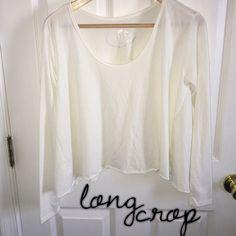 NWOT long sleeve white crop top NWOT! Long sleeve, longer cropped shirt Tops Crop Tops