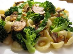 Love pasta too much!  Orecchiette with broccoli, mushrooms and roasted garlic in a light lemon butter sauce.
