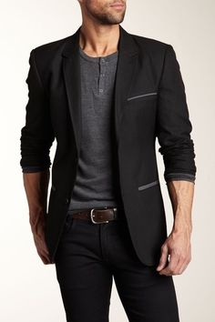 Black blazer w/ charcoal accessories, grey half-button collarless shirt, brown belt and navy skinny jeans