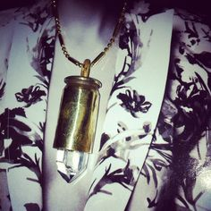 CRYSTAL CARNATIONS. Designed and hand made by me, Marcia Rennert. Brass bullet casing with a huge quartz crystal.