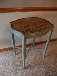 A side table painted in duck egg blue and then the top has been decoupaged with a French script.