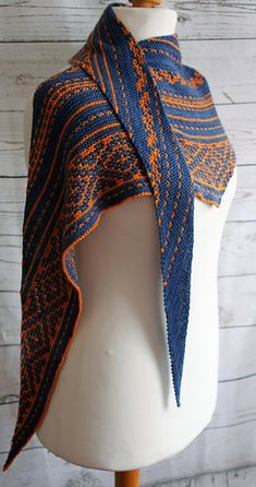 Iberian Dreams is a long, shallow, asymmetrical triangular shawl knit from end to end without a single purl stitch. The colourful patterns are created with slipped stitches so you are only ever working with one colour yarn at a time.