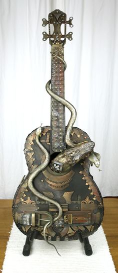 Guitar decorated in the style of fantasy and post apo, by Zdeňka Otipková