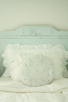 Lovely shade of blue, and I love the name in script on the headboard. I'm looking for an old headboard or door to paint this color.