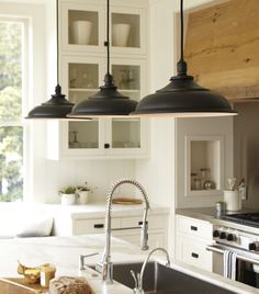 Rejuvenation: Baltimore Kitchen Rustic wooden hood, lighting, marble, faucet