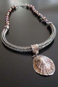 Jill Rockwell     Necklace: Sea Treasure from Cannes Handwoven Viking Knit in silver, Limpet molded from a real one collected off La Croissette in Cannes, France, and made of pure silver, oxidized. Freshwater pearls in a shimmery copper.