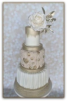 Elegant white and gold wedding cake. The bottom tier is cake lace painted gold, the next tier is pleated and impressed fondant , the next is a pearl and Brooch tier, the top tier is painted gold on white. There are 2 painted gold separators and it. Unique Cakes, Elegant Cakes, Gorgeous Cakes, Pretty Cakes, Amazing Wedding Cakes, Amazing Cakes, Cupcakes, Cupcake Cakes, Metallic Cake